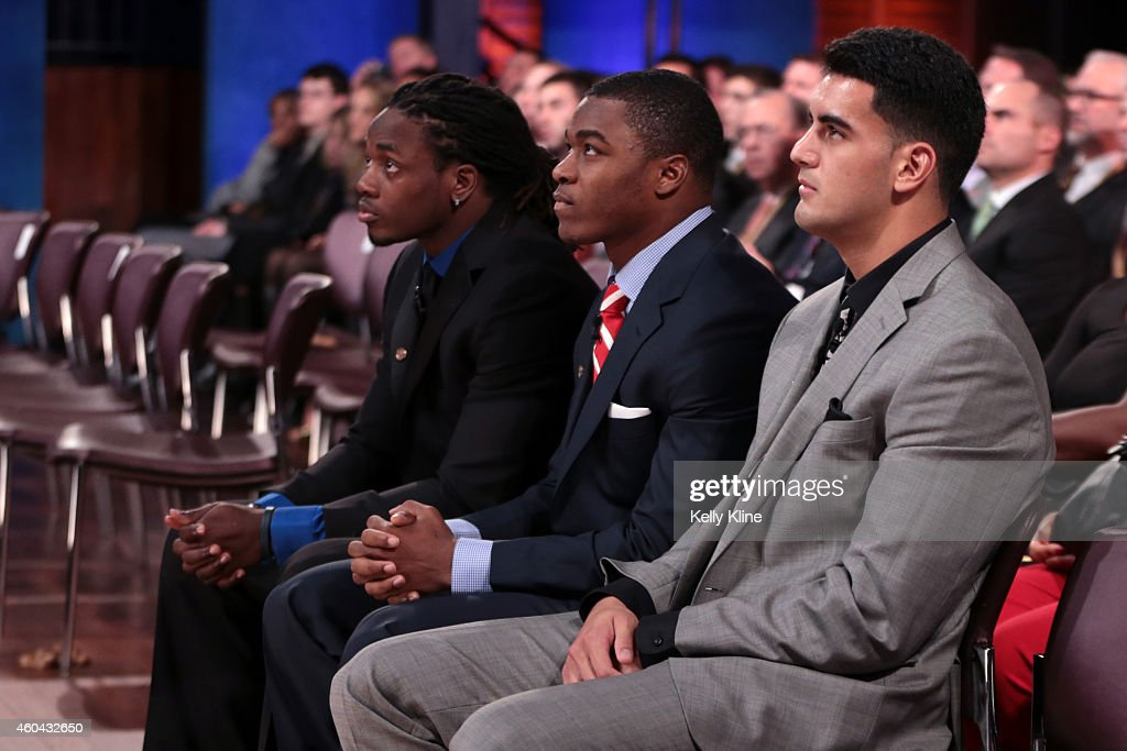Melvin Gordon, quarterback for the University of Wisconsin Badgers, Amari Cooper, wide receiver for the University of Alabama Crimson Tide, and Marcus Mariota, quarterback for the University of Oregon Ducks, look on prior to being named the 80th Heisman Memorial Trophy Award winner during the 2014 Heisman Trophy Presentation at the Best Buy Theater on December 13, 2014 in New York City.