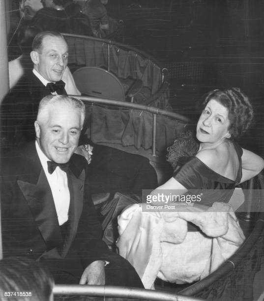 Melvin J Roberts Clarence J Daly and Mrs Daly photographed in their box Mrs Daly's olivegreen crepe gown was among the many fashionable and lovely...