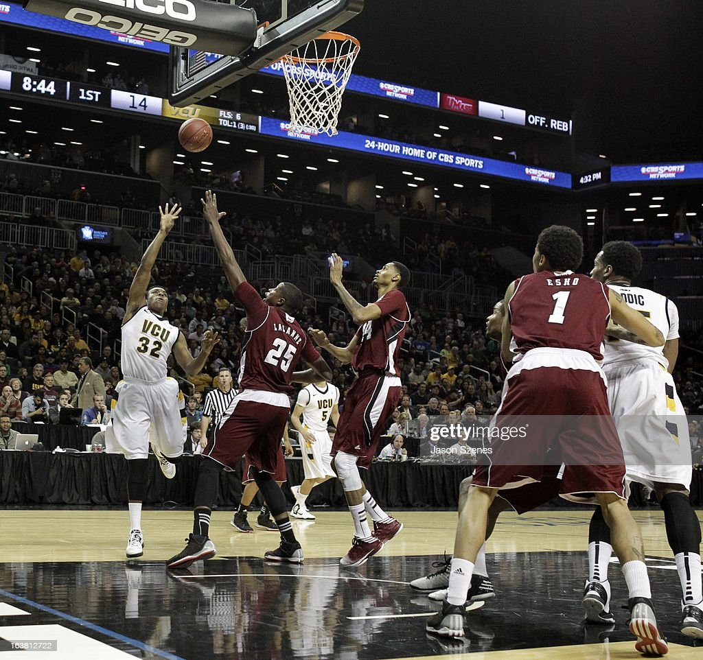 Melvin Johnson #32 of the Virginia Commonweath Rams puts up a shot past Cady Lalanne #25 of the Massachusetts Minutemen in the first half during the Atlantic 10 Basketball Tournament - Semifinals at the Barclays Center on March 16, 2013 in the Brooklyn borough of New York City.