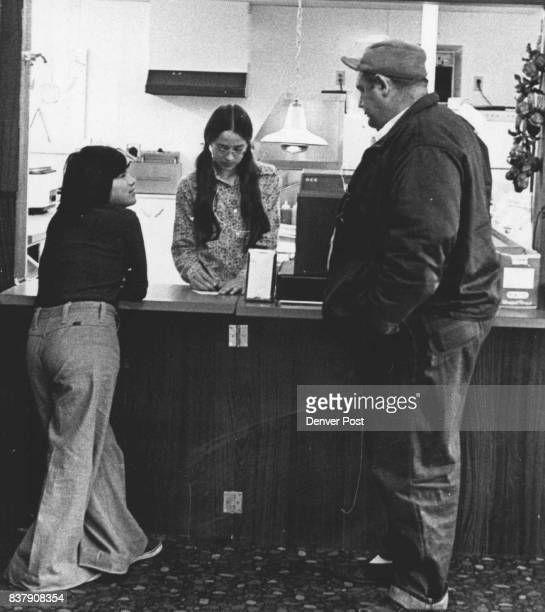 Melvin Lei and Luz Elna Romera Amezquita one of the 57 children Lei cares for order a snack above at a Sterling Colo fastfoodtaco stand then eat...