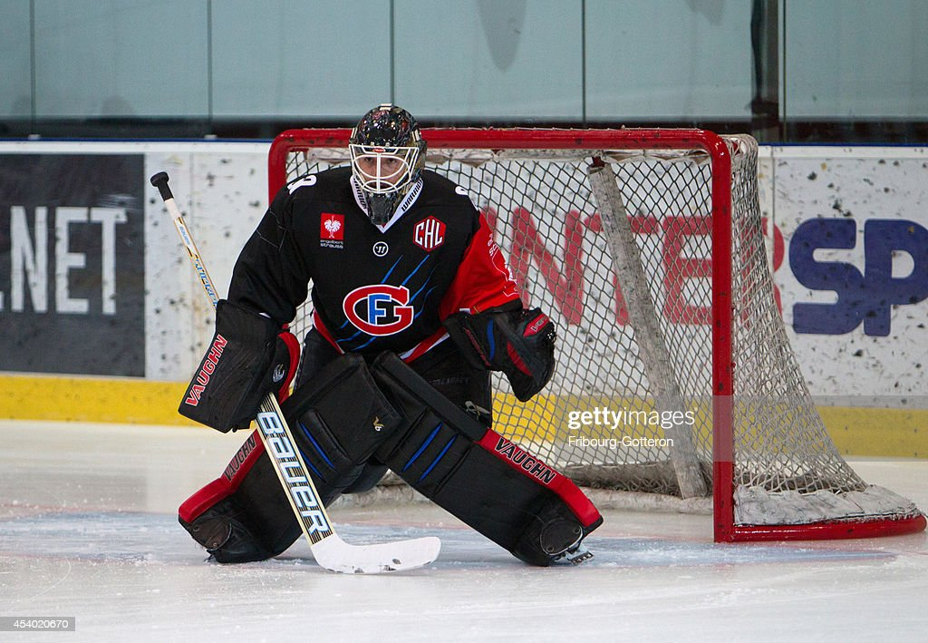 Melvin Nyffeler makes a save on pre-game during the group stage match between Fribourg-Gotteron and Eisbaeren Berlin on August 23, 2014 in Fribourg, Switzerland.