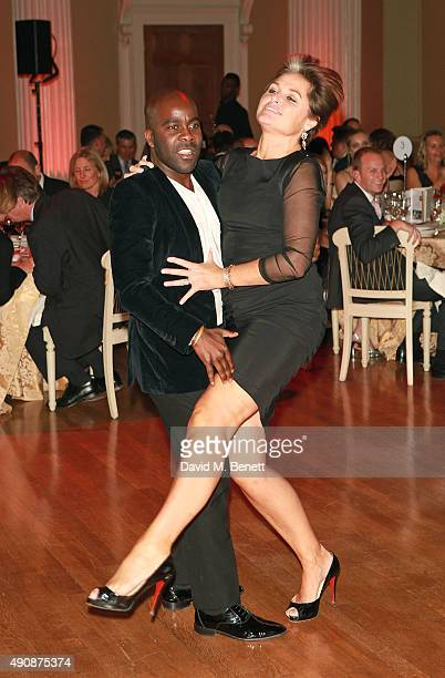 Melvin Odoom and guest attend a fundraising event in aid of the Nepal Youth Foundation hosted by David Walliams at Banqueting House on October 1 2015...