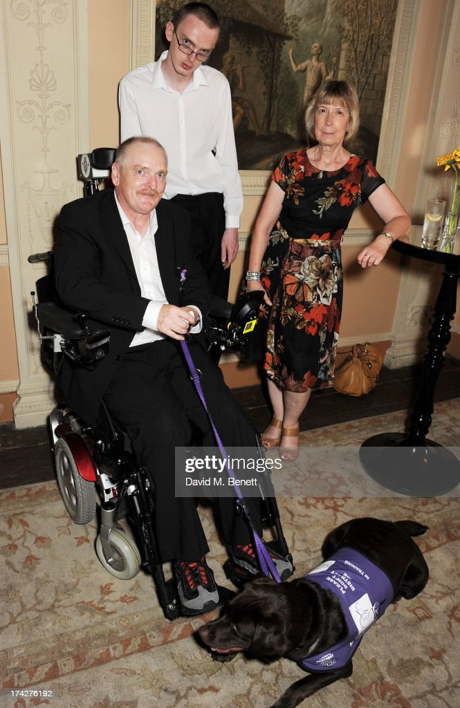 Melvin O'Dowd (L) with dog Alice, and Jenny Moir (R) attend the Dogs Trust Honours held at Home House on July 23, 2013 in London, England.