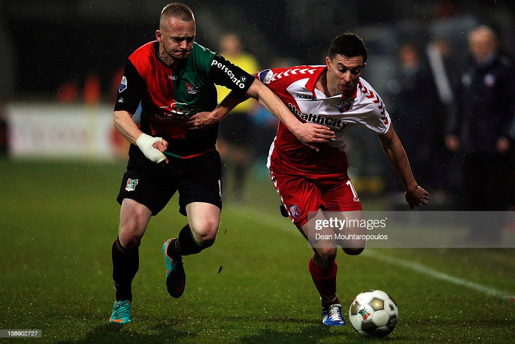 Melvin Platje of NEC and Tommy Oar (#10) of Utrecht battle for the ball during the Eredivisie match between NEC Nijmegen and FC Utrecht at the McDOS Goffertstadion on November 24, 2012 in Nijmegen, Netherlands.