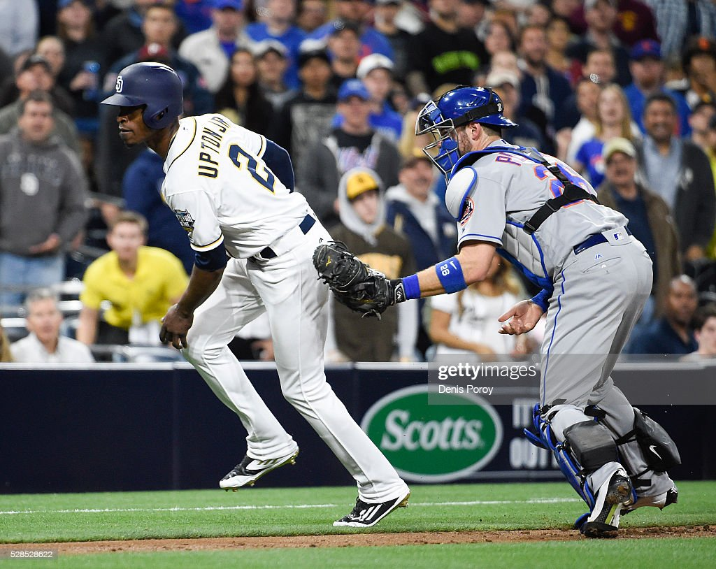 Melvin Upton Jr. #2 of the San Diego Padres is tagged out by Kevin Plawecki #26 of the New York Mets after he was caught in run down during the third inning of a baseball game at PETCO Park on May 5, 2016 in San Diego, California.