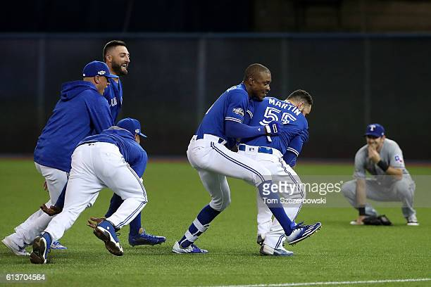 Melvin Upton Jr #7 of the Toronto Blue Jays celebrates with teammate Russell Martin after the Toronto Blue Jays defeated the Texas Rangers 76 during...