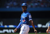 Melvin Upton Jr #7 of the Toronto Blue Jays leads off first base after hitting a single in the sixth inning during MLB game action against the San...