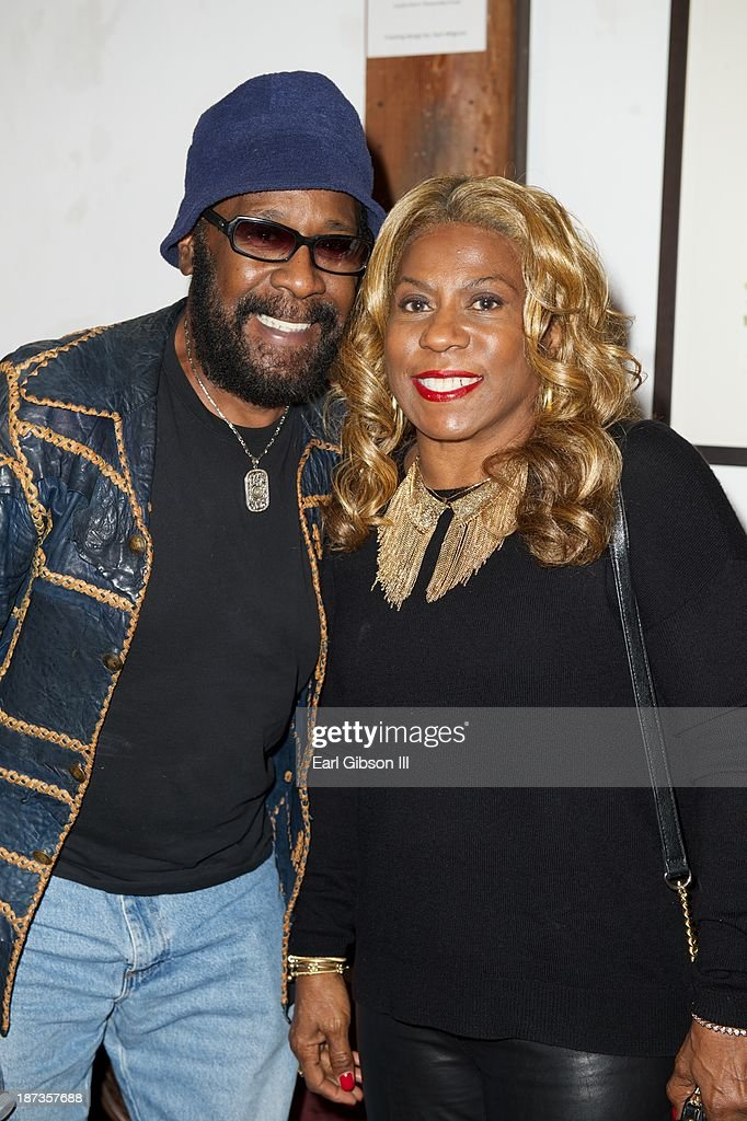 Melvin 'Wah-Wah Watson' Ragin and Cheryl Davis pose for a photo at the 'Miles Davis: The Collected Artwork' Launch Party at Mr. Musichead Gallery on November 7, 2013 in Los Angeles, California.