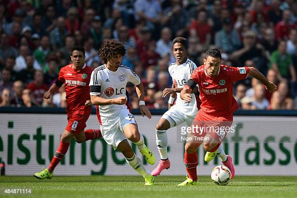 Melvut Erdinc of Hannover is challenged by Andre Ramalho of Leverkusen during the Bundesliga match between Hannover 96 and Bayer 04 Leverkusen at...