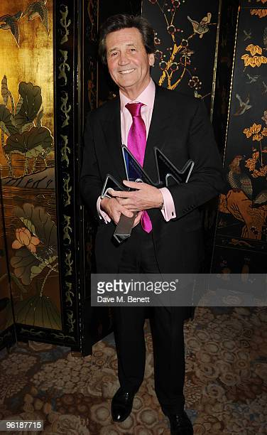 Melvyn Bragg poses with his Outstanding Achievement Award at the South Bank Show Awards at The Dorchester on January 26 2010 in London England