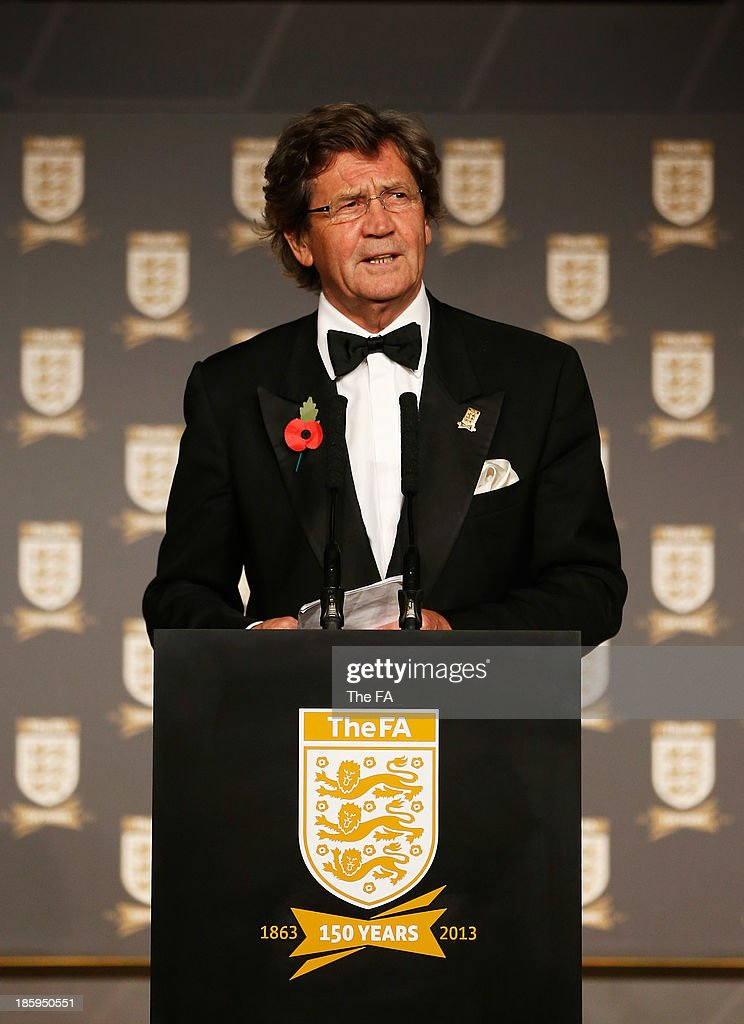 <a gi-track='captionPersonalityLinkClicked' href=/galleries/search?phrase=Melvyn+Bragg&family=editorial&specificpeople=220187 ng-click='$event.stopPropagation()'>Melvyn Bragg</a> talks on stage during the FA150 Gala Dinner commemorating the Football Association's 150th year at the Grand Connaught Rooms on October 26, 2013 in London, England.