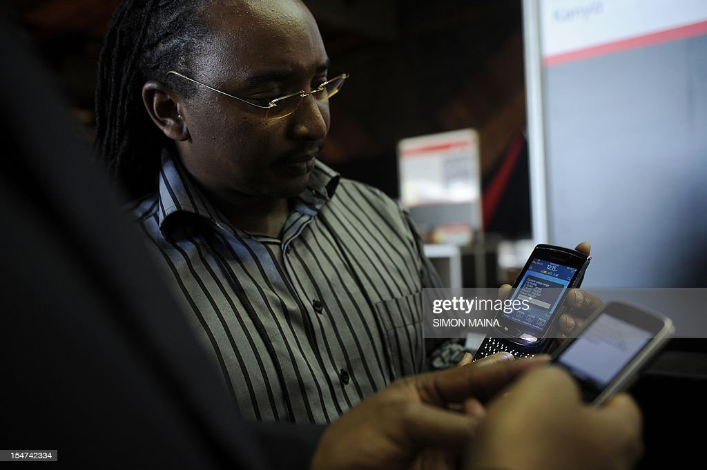 Mem Maina, an African enterpreneur, presents various new applications designed for phones on October 25, 2012, during the DEMO Africa technology fair at the Kenyatta International Conference Center in Nairobi, where some fourty start-up firms in the technology and communication business are seeking to raise $60 million (Sh5.04 billion) by showcasing their products or prototypes. Nairobi over the past decade has earned the nickname 'Silicon Sahara' for its entrepreneurial prowess and growing culture of innovation and research. The DEMO Africa conference takes place from October 24 to 26 and provides a platform for start-ups from across Africa to pitch for growth capital and strategic partnerships, with the aim of developing the companies' ability to compete with tech startups across the globe.