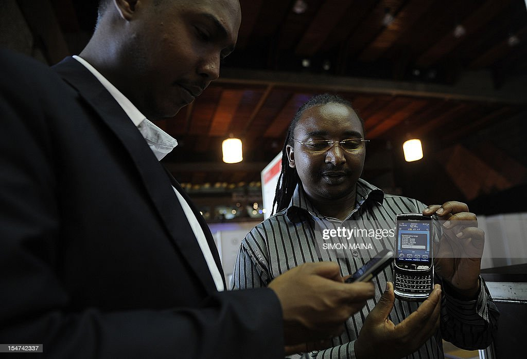 Mem Maina (R), an African enterpreneur, presents various new applications designed for phones on October 25, 2012, during the DEMO Africa technology fair at the Kenyatta International Conference Center in Nairobi, where some fourty start-up firms in the technology and communication business are seeking to raise $60 million (Sh5.04 billion) by showcasing their products or prototypes. Nairobi over the past decade has earned the nickname 'Silicon Sahara' for its entrepreneurial prowess and growing culture of innovation and research. The DEMO Africa conference takes place from October 24 to 26 and provides a platform for start-ups from across Africa to pitch for growth capital and strategic partnerships, with the aim of developing the companies' ability to compete with tech startups across the globe. AFP PHOTO/SIMON MAINA