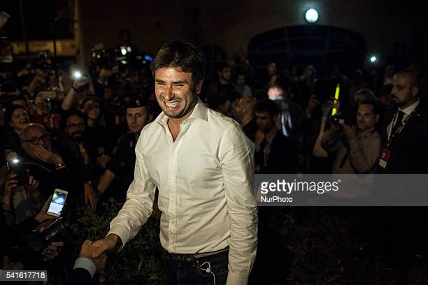 M5S member Alessandro Di Battista greets supporters of newly elected mayor of Rome Five Star Movement's candidate Virginia Raggi after the winning of...