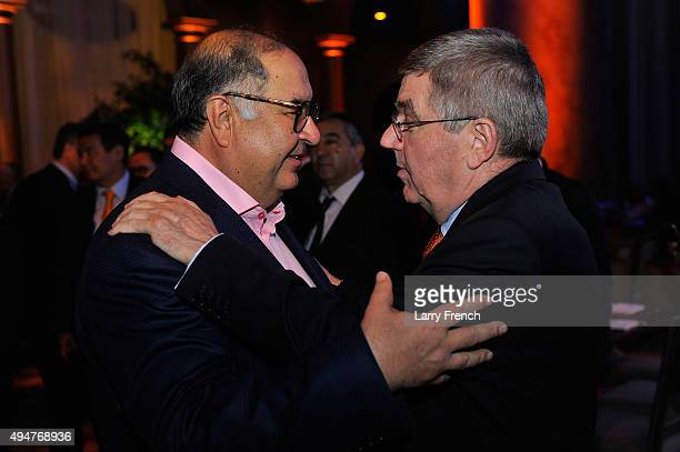 IOC member Alisher Usmanov greets IOC President Thomas Bach at the USOC Welcome reception at the National Building Museum ahead of the XX ANOC...