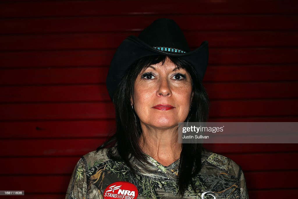 NRA member Becky Lou Lacock poses for a photograph during the 2013 NRA Annual Meeting and Exhibits at the George R. Brown Convention Center on May 5, 2013 in Houston, Texas. Fifty eight year-old Becky Lou Lacock, an outdoors and shooting writer from Spring, Texas has been a member of the NRA for ten years. She owns over 50 guns with her favorite being the Browning 243 X Bolt. The NRA has more than 5 million members.