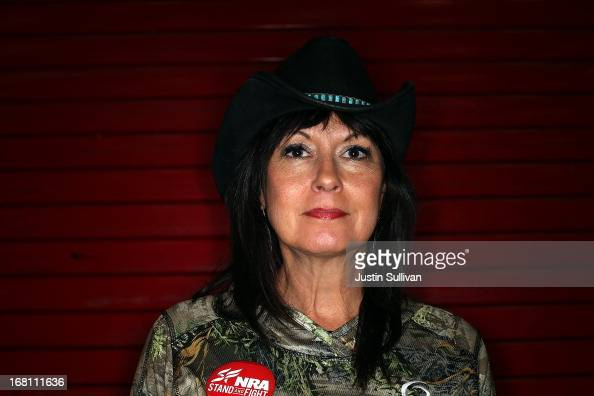 NRA member Becky Lou Lacock poses for a photograph during the 2013 NRA Annual Meeting and Exhibits at the George R Brown Convention Center on May 5...