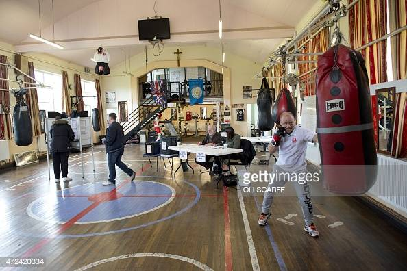 A member boxes as the public vote at East Hull Amateur Boxing Club which is being used as a polling station in Hull Northern England on May 7 2015 as...
