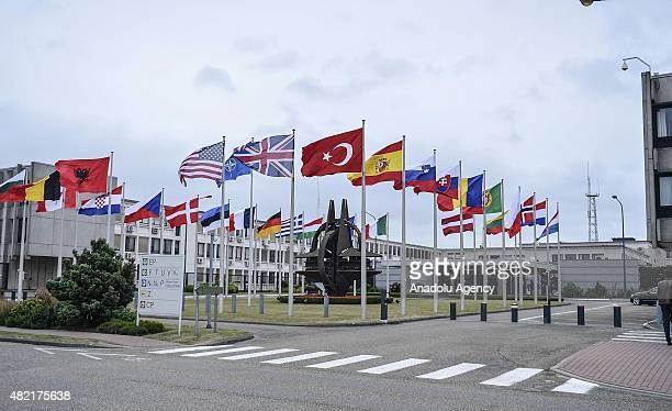 Member countries' flags are seen in front of the NATO Headquarters ahead of the extraordinary meeting due to Turkey's demand for the lately terrorist...