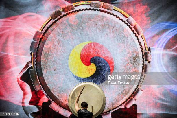 A member from Korean drumming group Tago performs live on stage during the London Korean Festival 2017 at Olympia London on July 8 2017 in London...