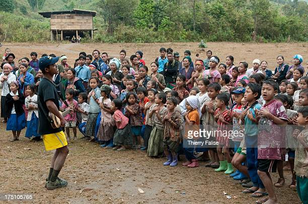 A member from the relief group Free Burma Rangers conducts games for children of a community of displaced people