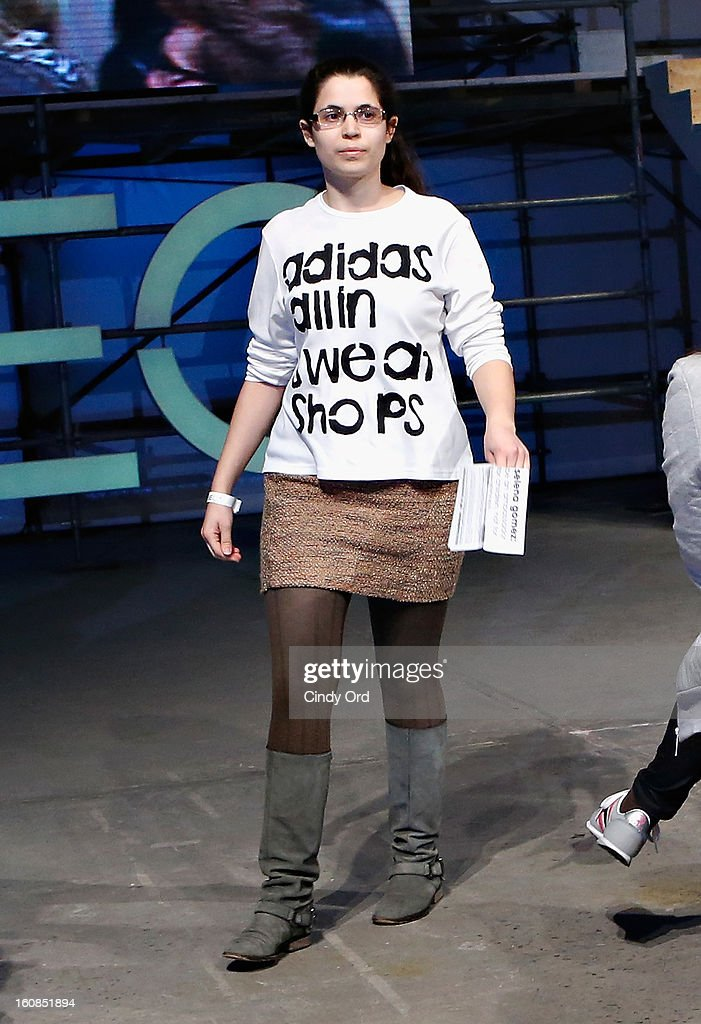 member hands out flyers in protest during the adidas NEO Label Fall 2013 fashion show on February 6, 2013 in New York City.