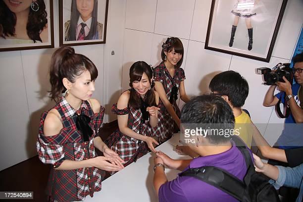 AKB48 member Kikuchi Ayaka Katayama Haruka and Abe Maria held handshaking activity for fans on Tuesday July 02 2013 in Taipei Taiwan China