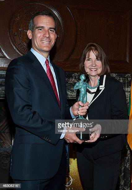 Member Los Angeles Mayor Eric Garcetti and Executive Producer Kathy Connell pose with the SAG Award Trophy on January 14 2014 in Hollywood California