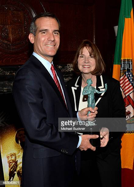 Member Los Angeles Mayor Eric Garcetti poses with SAG Awards Executive Producer Kathy Connell as he casts his vote for the 20th Annual Screen Actors...