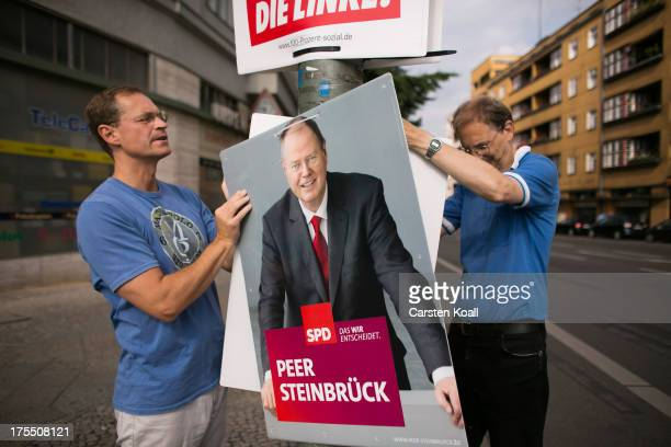 SPD Member Michael Mueller Senator for Urban Development and Christian Heidler SPDMember since 1980 hang election campaign posters showing German...