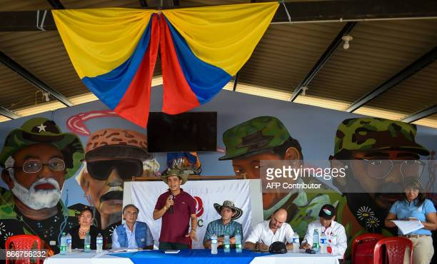 FARC member named Montes speaks during a meeting next to UN SecretaryGeneral's Special Representative for Colombia and Head of the UN Mission to...