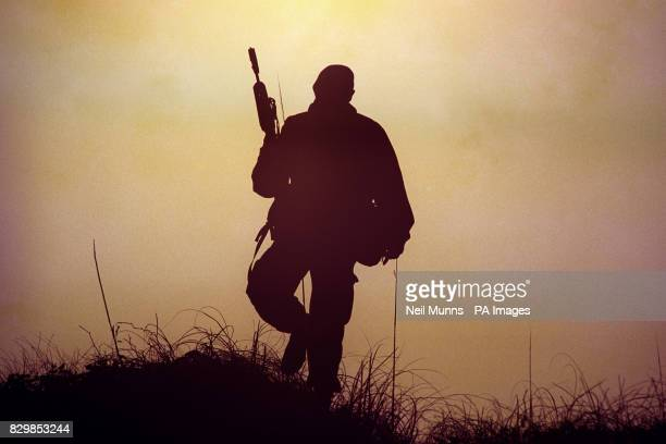 A member of 42 Commando Royal Marines overlooks the Onslow beach this morning after taking part in a combined joint forces operation of the coast of...