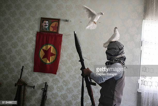 A member of a armed group Patriotic Revolutionary Youth Movement a youth division of the Kurdistan Workers' Party PKK prepares his holds a Rocket...