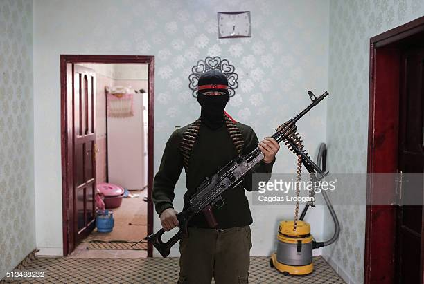 A member of a armed group Patriotic Revolutionary Youth Movement a youth division of the Kurdistan Workers' Party PKK pose with his automatic rifle...