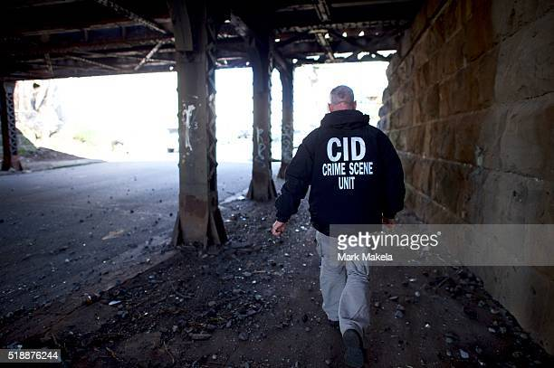 A member of a crime scene unit walks near the site of the Amtrak Palmetto train 89 crash on April 3 2016 in Chester Pennsylvania Two people are...