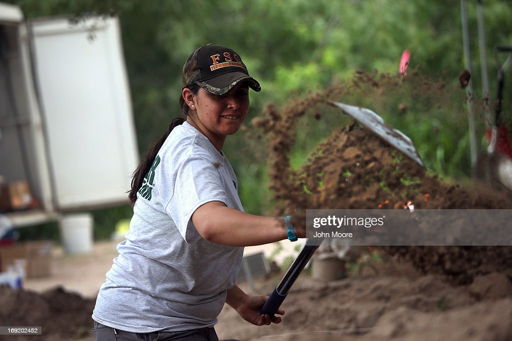 A member of a forensic anthropology team from Baylor University unearths the remains of unidentified immigrants from a cemetery on May 21, 2013 in Falfurrias, Texas. Teams from Baylor University and the University of Indianapolis are exhuming the bodies of more than 50 immigrants who died, mostly from heat exhaustion, while crossing illegally from Mexico into the United States. The bodies will be examined and cross checked with DNA sent from Mexico and Central American countries, with the goal of reuniting the remains with families. In Brooks County alone, at least 129 immigrants perished in 2012, the highest rate in the United States, according to forensic anthropologists.