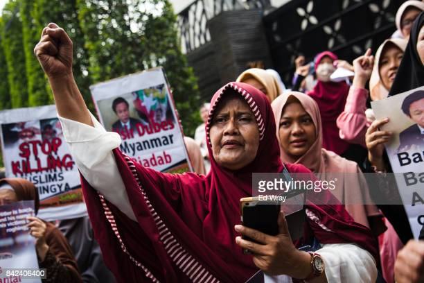 Member of a group calling themselves friends of Muslim Rohingya shouts 'God is Great' during a rally by hundreds of the women's group in front of the...