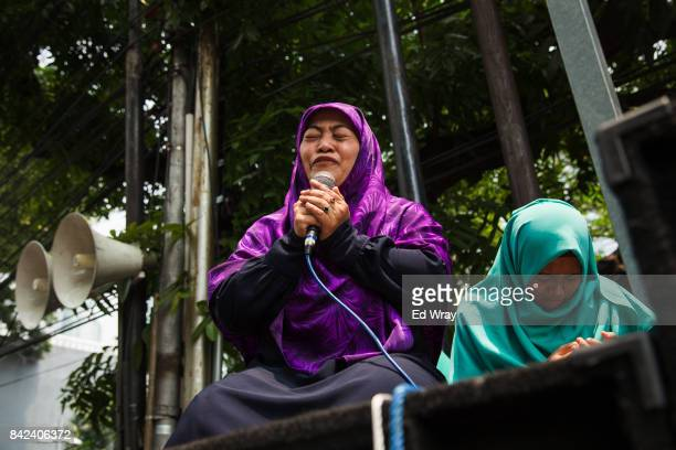 Member of a group calling themselves friends of Muslim Rohingya weeps as she recites an account of atrocities alleged to have been committed by...