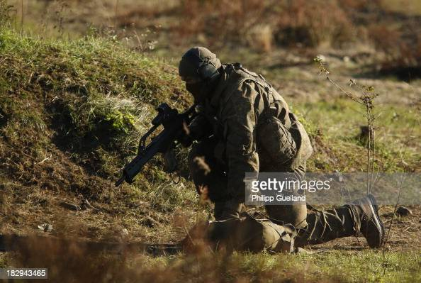 A member of a long range reconaissance patrol operates during the annual military exercises held for the media at the Bergen military training...