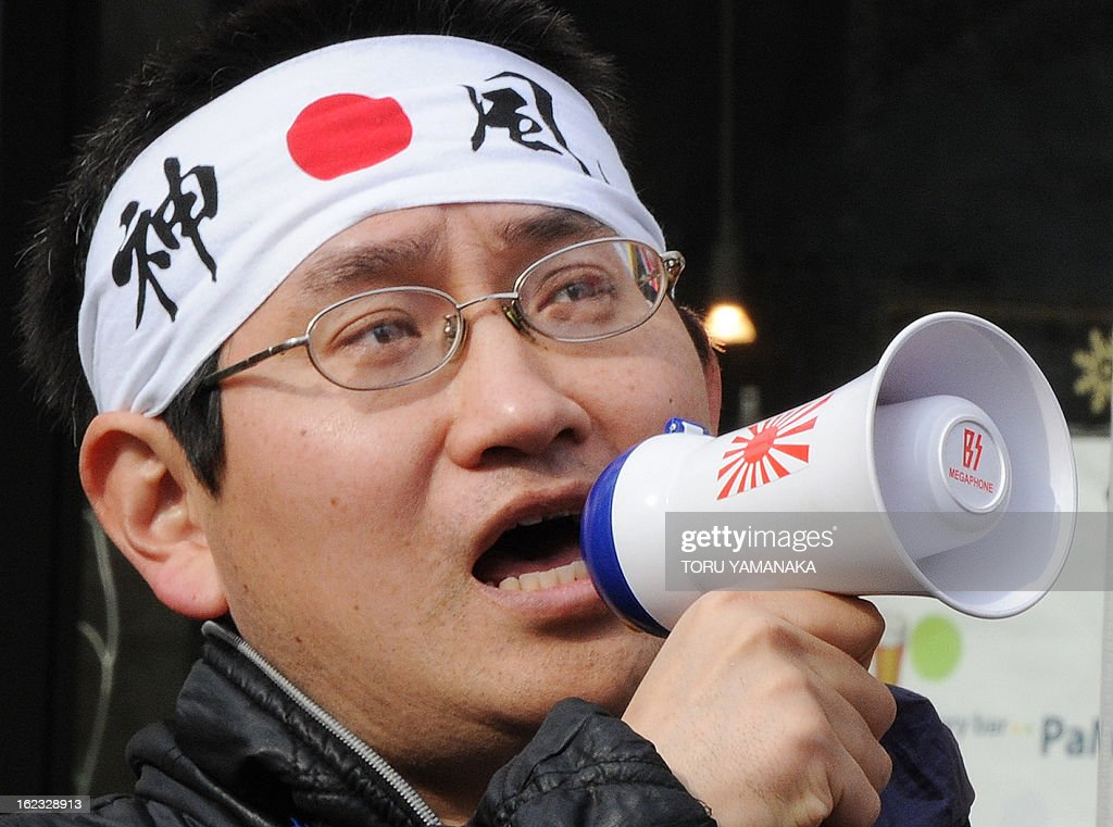 A member of a nationalist group shouts slogans during a rally in Tokyo over a set of tiny islands in the Sea of Japan (East Sea) that are controlled by South Korea, which are known as the Dokdo in South Korea and Takeshima in Japan and at the centre of a long-standing territorial feud, on February 22, 2013. A few dozen people took part in the rally on the street near the South Korean Embassy. AFP PHOTO / Toru YAMANAKA