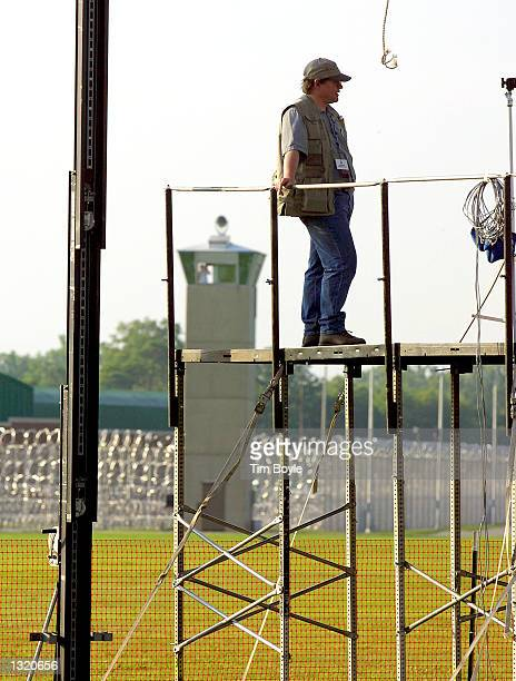 A member of a television news crew is seen June 8 2001 on scaffolding near the grounds of the US Federal Prison in Terre Haute Indiana Oklahoma City...