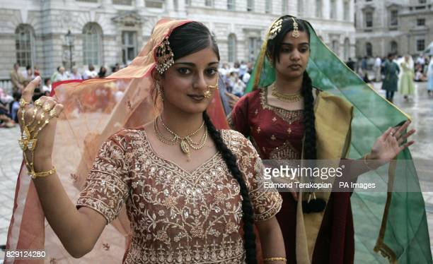 A member of Akademi South Asian Dance UK in the fountains at Somerset House on the Strand central London Wednesday 11 August 2004 in 'Waterscapes' a...
