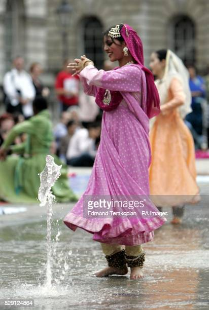 A member of Akademi South Asian Dance UK in the fountains at Somerset House on the Strand central London in 'Waterscapes' a specially commissioned...