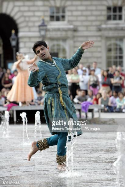 A member of Akademi South Asian Dance UK performs in the fountains at Somerset House on The Strand central London in 'Waterscapes' a specially...