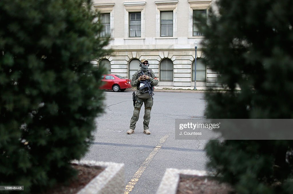 A member of an FBI security team watches a Federal Building during the 57th United States Presidential Inauguration ceremony at the National Mall on January 21, 2013 in Washington, DC.