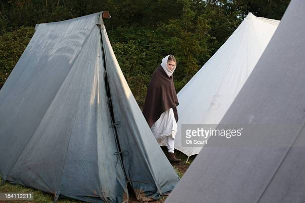 A member of an historical reenactment group walks through the Norman encampment before the annual reenactment of the Battle of Hastings at Battle...