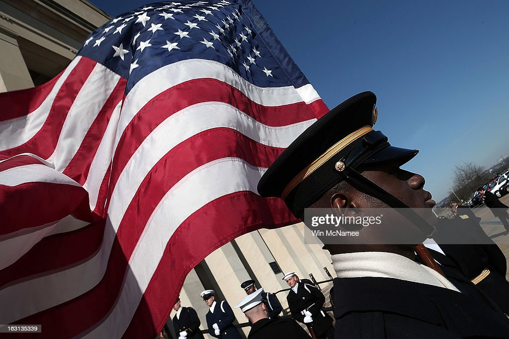 A member of an honor guard team stands at attention prior to U.S. Secretary of Defense Chuck Hagel welcoming Israeli Minister of Defense Ehud Barak to the Pentagon March 5, 2013 in Arlington, Virginia. Hagel and Barak were scheduled to meet privately at the Pentagon.