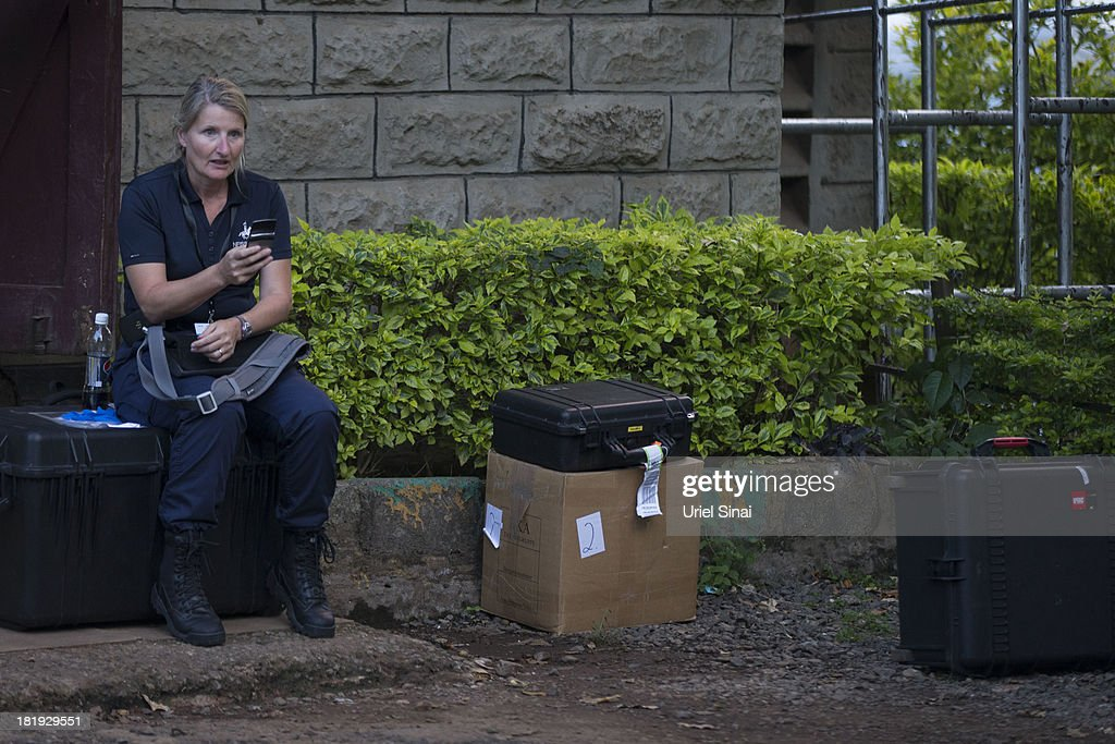 A member of an International forensic team sits outside the city mortuary on September 26, 2013 in Nairobi, Kenya. The country is observing three days of national mourning as security forces begin the task of clearing and securing the Westgate shopping mall following a four-day siege by militants.