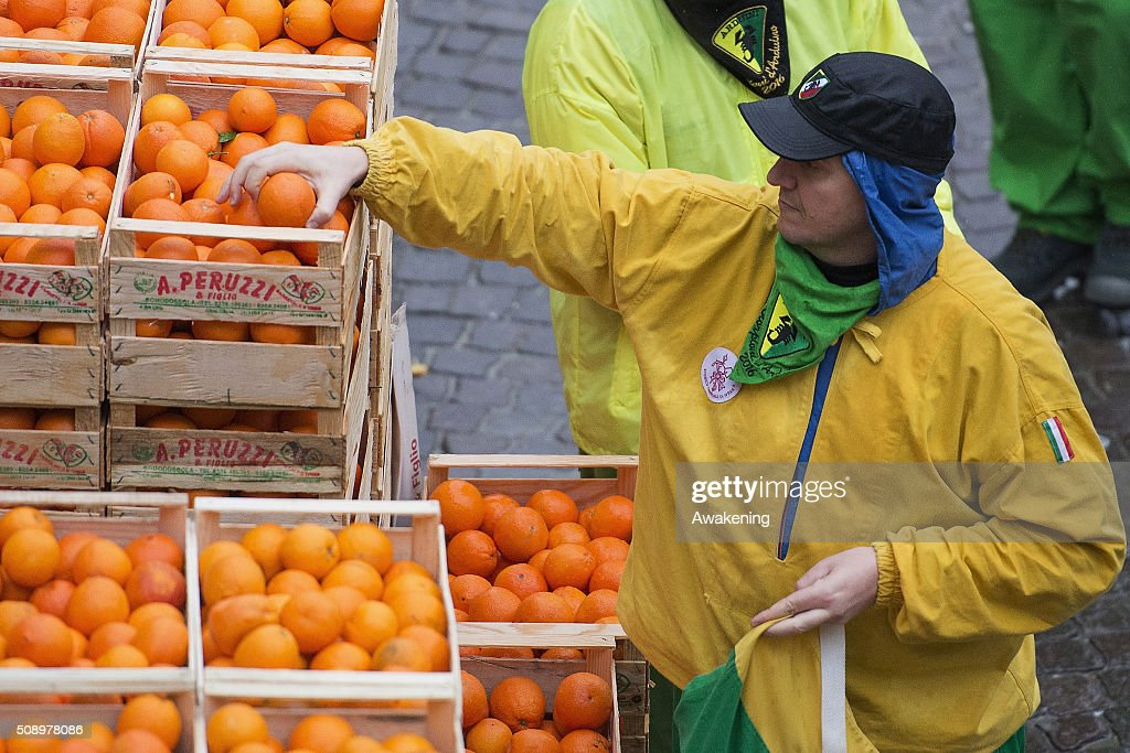 A member of an orange battle team takes part in the traditional 'battle of the oranges' held during the Ivrea Carnival on February 7, 2016 in Ivrea, near Turin, Italy. During the event which marks the people's rebellion against tyrannical lords who ruled the town in the Middle Ages, revellers parading on floats represent guards of the tyrant, while those on foot the townsfolk.