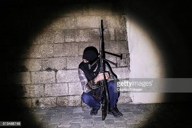 A member of armed group Patriotic Revolutionary Youth Movement a youth division of the Kurdistan Workers' Party PKK prepare for an attack to Turkish...